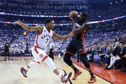 Luol Deng #9 of the Miami Heat shoots the ball as Kyle Lowry #7 of the Toronto Raptors defends in the first half of Game One of the Eastern Conference Semifinals during the 2016 NBA Playoffs at the Air Canada Centre on May 3, 2016 in Toronto, Ontario, Canada.  NOTE TO USER: User expressly acknowledges and agrees that, by downloading and or using this photograph, User is consenting to the terms and conditions of the Getty Images License Agreement.