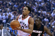 DeMar DeRozan #10 of the Toronto Raptors drives to basket as Luol Deng #9 of the Miami Heat defends in the first half of Game Two of the Eastern Conference Semifinals during the 2016 NBA Playoffs at the Air Canada Centre on May 5, 2016 in Toronto, Ontario, Canada.  NOTE TO USER: User expressly acknowledges and agrees that, by downloading and or using this photograph, User is consenting to the terms and conditions of the Getty Images License Agreement.