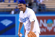 Olympic swimmer Kosuke Kitajima of Japan prepares to throw out a ceremonial first pitch before the game against the Miami Marlins at Dodger Stadium on May 18, 2017 in Los Angeles, California.