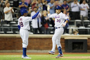 Michael Conforto #30 of the New York Mets celebrates his two run home run with teammate Rajai Davis who also scored on the play  in the ninth inning against the Miami Marlins at Citi Field on September 24, 2019 in the Flushing neighborhood of the Queens borough of New York City.