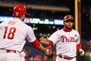 Andres Blanco #4 of the Philadelphia Phillies is congratulated by Darin Ruf #18 after scoring a run off of a Maikel Franco #7 single in the sixth inning of the second game of a double header against the Miami Marlins at Citizens Bank Park on October 3, 2015 in Philadelphia, Pennsylvania. The Marlins won 5-2.