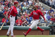 Andres Blanco #4 slaps ands with Tyler Goeddel #2 of the Philadelphia Phillies after scoring a run in the bottom of the third inning against the Miami Marlins at Citizens Bank Park on May 18, 2016 in Philadelphia, Pennsylvania.