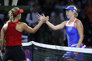 Angelique Kerber of Germany shakes hands at the net after her straight sets victory against Anastasia Pavlyuchenkova of Russia in their third round match during the Miami Open Presented by Itau at Crandon Park Tennis Center on March 24, 2018 in Key Biscayne, Florida.