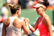 Simona Halep of Romania congratulates Agnieszka Radwanska of Poland after their match during the Miami Open Presented by Itau at Crandon Park Tennis Center  on March 24, 2018 in Key Biscayne, Florida.