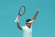 Roger Federer of Switzerland celebrates at match point against John Isner of USA in the final during day fourteen of the Miami Open tennis on March 31, 2019 in Miami Gardens, Florida.