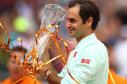 Roger Federer of Switzerland celebrates with the winners trophy against John Isner of USA in the final during day fourteen of the Miami Open tennis on March 31, 2019 in Miami Gardens, Florida.