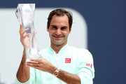 Roger Federer of Switzerland celebrates with the Butch Buchholz Trophy after defeating John Isner during the men's final of the Miami Open Presented by Itau at Hard Rock Stadium March 31, 2019 in Miami Gardens, Florida.