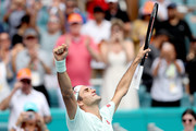 Roger Federer of Switzerland celebrates his win against John Isner during the men's final of the Miami Open Presented by Itau at Hard Rock Stadium March 31, 2019 in Miami Gardens, Florida.