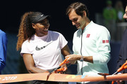 (from left) Serena Williams of the United States and Roger Federer of Switzerland cut the ribbon during the Ribbon Cutting ceremony on Day 3 of the Miami Open Presented by Itau on March 20, 2019 in Miami Gardens, Florida.
