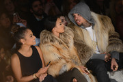 (L-R) Christina Milian, Karrueche Tran, and Chris Brown attend the Michael Costello fashion show during Mercedes-Benz Fashion Week Fall 2015  at The Salon at Lincoln Center on February 17, 2015 in New York City.