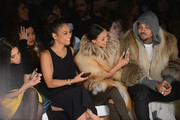Christina Milian, Karrueche Tran, and Chris Brown (R) attend the Michael Costello fashion show during Mercedes-Benz Fashion Week Fall 2015  at The Salon at Lincoln Center on February 17, 2015 in New York City.