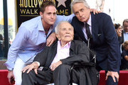 Cameron Douglas, Kirk Douglas, and Michael Douglas pose at the Michael Douglas Star On The Hollywood Walk Of Fame ceremony on November 6, 2018 in Hollywood, California.