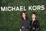 Elena Radonicich and Catrinel Marlon attend Michael Kors To Celebrate Milano on December 4, 2013 in Milan, Italy.