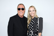 Michael Kors and Harley Viera-Newton pose backstage during the Michael Kors FW20 Runway Show on February 12, 2020 in New York City.
