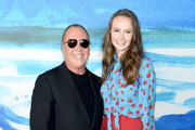 Michael Kors (L) and Andi Matichak pose backstage during the Michael Kors Collection Spring 2019 Runway Show at Pier 17 on September 12, 2018 in New York City.