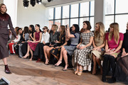 A model walks the runway as Bryanboy, a guest, Tao Okamoto, Ming Xi, Olivia Palermo, Alexandra Richards, Harley Viera-Newton, Leigh Lezark, Hanneli Mustaparta, Poppy Delevingne, and Jessica Hart look on at the Michael Kors fashion show during Mercedes-Benz Fashion Week Fall 2015 at Spring Studios on February 18, 2015 in New York City.