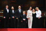 """(L to R) Actors Viktor Tremmel, Michael Fuith, director Markus Schleinzer, actors David Rauchenberger, Ursula Strauss, Gisella Salcher and Christine Kain attend the """"Michael"""" premiere at the Palais des Festivals during the 64th Cannes Film Festival on May 14, 2011 in Cannes, France."""