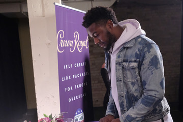 Michael Roberts Crown Royal Packs Bags for Troops at The Rolling Stone Party