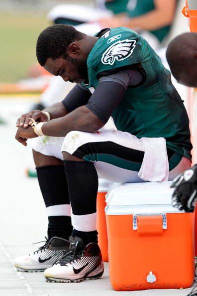 A disappointed Michael Vick hangs his head on the sidelines. Photo by Chris Trotman/Getty Images North America