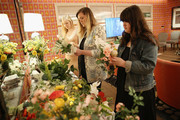 Guests make bouquets during the Michaels Weddings & David Tutera Royal Wedding watch party on May 19, 2018 in New York City.