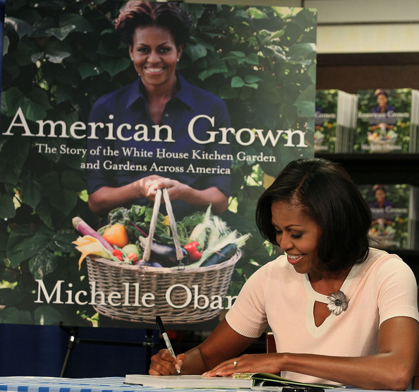 Michelle Obama Photos Photos Michelle Obama Signs Copies Of Her