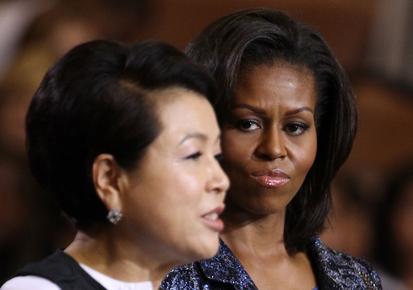 Michelle Obama U.S. first lady Michelle Obama (R) listens as South Korean first lady Kim Yoon-ok speaks as they visit Annandale High School October 13, 2011 in Annandale, Virginia. First lady Kim will join her husband South Korean President Lee Myung-bak, who is on a state visit in Washington, to attend a state dinner hosted by President Barack Obama and first lady Michelle Obama this evening.