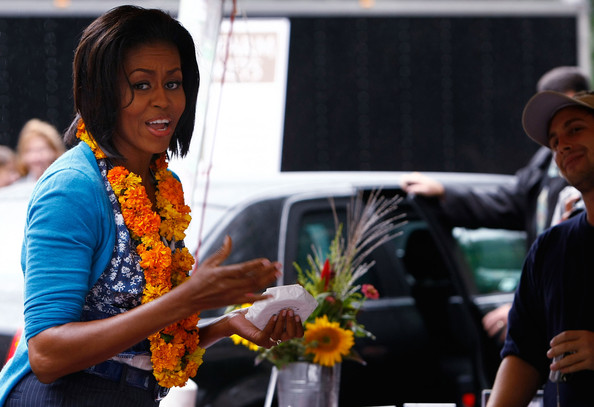 Michelle Obama Visits New Farmers Market In Washington DC [yellow,event,community,fashion,fun,human,floristry,smile,flower,plant,michelle obama,city officials,farmers market,blocks,produce,new farmers market in washington dc,u.s.,shops,vendors,opening]