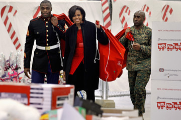 Bobby Clark Michelle Obama Visits A Toys For Tots Distribution Center