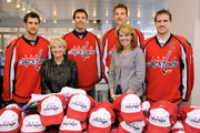 "(Back row, L-R) Washington Capitols players Brian Pothier, Mike Knuble, David Steckel and Chris Clark pose with Elaine B. Rogers (front row, left) and Teresa Carlson, Vice President, US Federal Government Microsoft Corporation (front row, right) during Microsoft's ""A Salute to Our Troops"" Operation USO Care Package Day at Kettler Iceplex on November 9, 2009 in Arlington, Virginia."
