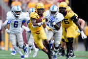 Rodney Smith #1 of the Minnesota Golden Gophers carries the ball against the Middle Tennessee Raiders during the first quarter of the game on September 16, 2017 at TCF Bank Stadium in Minneapolis, Minnesota.