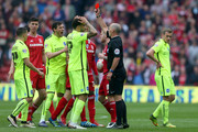 Referee Mike Dean shows the red card to Dale Stephens (not pictured) of Brighton and Hove Albion  during the Sky Bet Championship match between Middlesbrough and Brighton and Hove Albion at the Riverside Stadium on May 7, 2016 in Middlesbrough, United Kingdom.