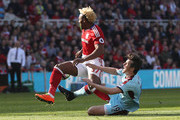 Adama Traore of Middlesbrough and Joey Barton of Burnley colide during the Premier League match between Middlesbrough and Burnley at Riverside Stadium on April 8, 2017 in Middlesbrough, England.