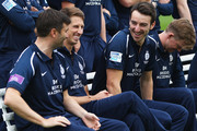 Toby Roland-Jones (right) of Middlesex is seen laughing with John Simpson (center) during the team photo during the Middlesex CCC Photocall at Lord's Cricket Ground on April 11, 2018 in London, England.