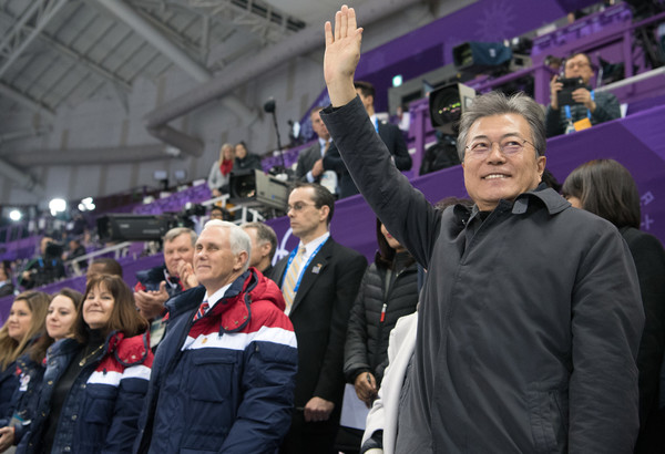 U.S. Vice President Mike Pence Visits South Korea - Day 3 [mike pence,karen,kim yo-jong,vice president,president,c,short track speed skating,product,purple,event,crowd,fan,competition event,sport venue,hand,stadium,gesture,south korea,u.s.,gangneung ice arena]