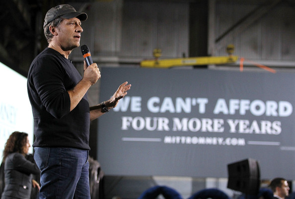 "Mike Rowe Television personality Mike Rowe speaks during a roundtable discussion with Republican U.S. presidential candidate Mitt Romney and business leaders at American Spring Wire September 26, 2012 in Bedford Heights, Ohio. Romney continued his two-day ""Romney Plan For A Stronger Middle Class"" bus tour in the state of Ohio."