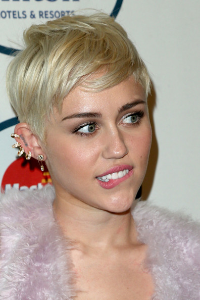 Miley Cyrus Recording artist Miley Cyrus attends the 56th annual GRAMMY Awards  Pre-GRAMMY Gala and Salute to Industry Icons honoring Lucian Grainge at The Beverly Hilton on January 25, 2014 in Beverly Hills, California.