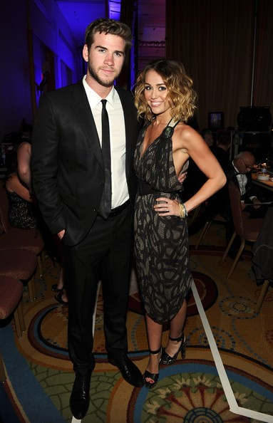 Miley Cyrus Actress/singer Miley Cyrus and Liam Hemsworth backstage during Muhammad Ali's Celebrity Fight Night XIII held at JW Marriott Desert Ridge Resort & Spa on March 24, 2012 in Phoenix, Arizona.