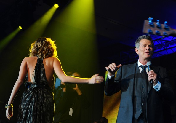 Miley Cyrus Musician David Foster and singer Miley Cyrus perform onstage during Muhammad Ali's Celebrity Fight Night XIII held at JW Marriott Desert Ridge Resort & Spa on March 24, 2012 in Phoenix, Arizona.
