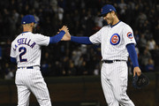 Tommy La Stella #2 of the Chicago Cubs and Anthony Rizzo #44 of the Chicago Cubs celebrate their win against the Milwaukee Brewers on April 26, 2018 at Wrigley Field  in Chicago, Illinois.  The Cubs won 1-0.