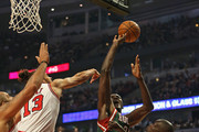 Joakim Noah #13 of the Chicago Bulls blocks a shot by Samuel Dalembert #21 of the Milwaukee Bucks as he tries to shoot over Loul Deng #9 and Carlos Boozer #5 at the United Center on November 26, 2012 in Chicago, Illinois. The Bucks defeated the Bulls 93-92. NOTE TO USER: User expressly acknowledges and agrees that, by downloading and or using this photograph, User is consenting to the terms and conditions of the Getty Images License Agreement.