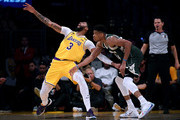 Giannis Antetokounmpo #34 of the Milwaukee Bucks fouls Anthony Davis #3 of the Los Angeles Lakers during the third quarter against the Los Angeles Lakers at Staples Center on March 06, 2020 in Los Angeles, California.  NOTE TO USER: User expressly acknowledges and agrees that, by downloading and or using this photograph, User is consenting to the terms and conditions of the Getty Images License Agreement.