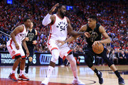 Giannis Antetokounmpo #34 of the Milwaukee Bucks dribbles the ball as Patrick Patterson #54 of the Toronto Raptors defends in the second half of Game Five of the Eastern Conference Quarterfinals during the 2017 NBA Playoffs at Air Canada Centre on April 24, 2017 in Toronto, Canada.  NOTE TO USER: User expressly acknowledges and agrees that, by downloading and or using this photograph, User is consenting to the terms and conditions of the Getty Images License Agreement.