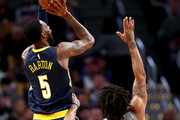 Will Barton #5 of the Denver Nuggets puts up a shot over Derrick Rose #25 of the Minnesota Timberwolves at the Pepsi Center on April 5, 2018 in Denver, Colorado. NOTE TO USER: User expressly acknowledges and agrees that, by downloading and or using this photograph, User is consenting to the terms and conditions of the Getty Images License Agreement.