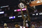 Clint Capela #15 of the Houston Rockets dunks the ball over Derrick Rose #25 of the Minnesota Timberwolves and Karl-Anthony Towns #32 in the first half during Game One of the first round of the 2018 NBA Playoffs at Toyota Center on April 15, 2018 in Houston, Texas.  NOTE TO USER: User expressly acknowledges and agrees that, by downloading and or using this photograph, User is consenting to the terms and conditions of the Getty Images License Agreement.