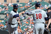 Justin Morneau #33 of the Minnesota Twins celebrates with Ryan Doumit #18 after scoring in the eighth inning against the Baltimore Orioles at Oriole Park at Camden Yards on April 8, 2012 in Baltimore, Maryland.