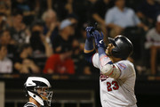 Nelson Cruz #23 of the Minnesota Twins celebrates following his solo home run during the seventh inning of a game against the Chicago White Sox at Guaranteed Rate Field on July 26, 2019 in Chicago, Illinois.