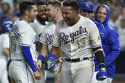 Salvador Perez #13 celebrates with Whit Merrifield #15 and members of the Kansas City Royals as he celebrates his walk-off grand slam against the Minnesota Twins in the ninth inning at Kauffman Stadium on September 14, 2018 in Kansas City, Missouri. The Royals won 8-4.