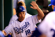 Raul Ibanez #18 of the Kansas City Royals is congratulaed in the dugout after scoring during the 5th inning of the game against the Minnesota Twins at Kauffman Stadium on July 31, 2014 in Kansas City, Missouri.