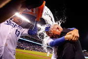 Salvador Perez #13 of the Kansas City Royals dumps a bucket of water over the heads of Eric Hosmer #35 and FOX broadcaster Joel Goldberg after the Royals defeated the Minnesota Twins 4-2 to win the game at Kauffman Stadium on September 8, 2015 in Kansas City, Missouri.