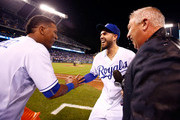Salvador Perez #13 of the Kansas City Royals celebrates with Eric Hosmer #35 after dumping a bucket of water over the heads of Hosmer and FOX broadcaster Joel Goldberg as the Royals defeat the Minnesota Twins 4-2 to win the game at Kauffman Stadium on September 8, 2015 in Kansas City, Missouri.
